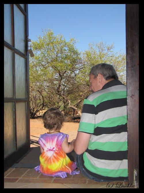 Baby and Grandfather surveying the bushveld
