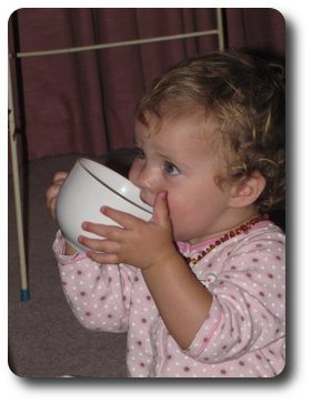 Drinking from a cup at 12 months